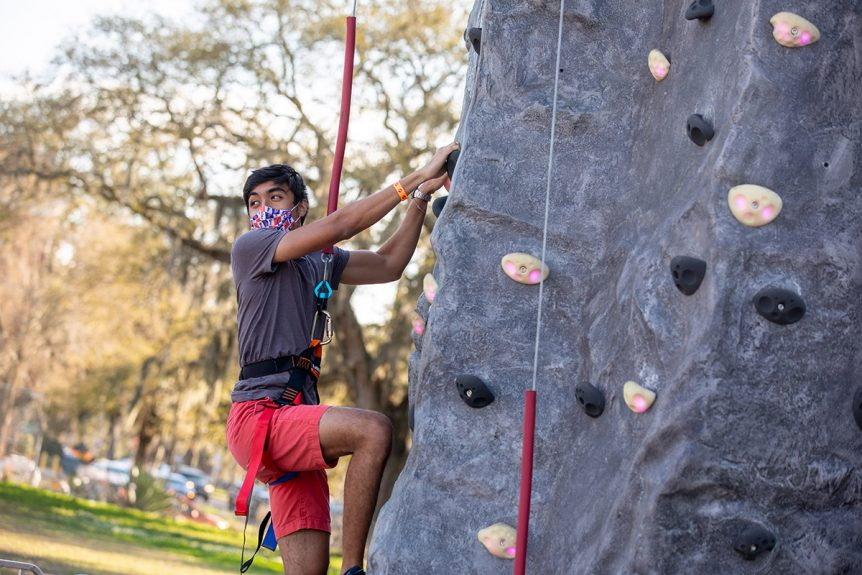 A student on a rock wall