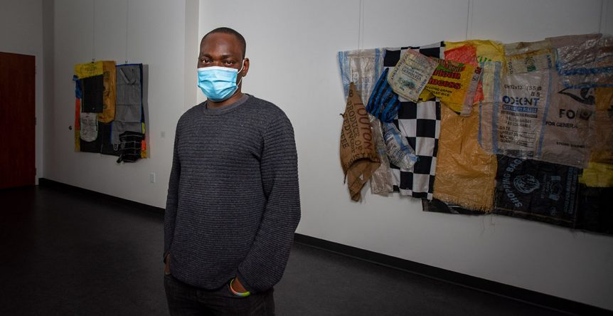 A person standing in front of artwork