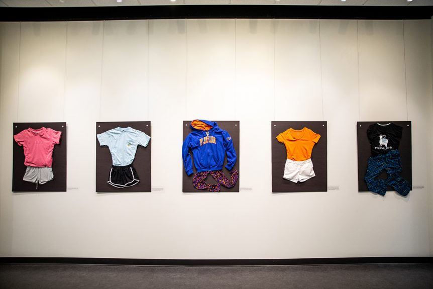 Clothes hanging in an art gallery