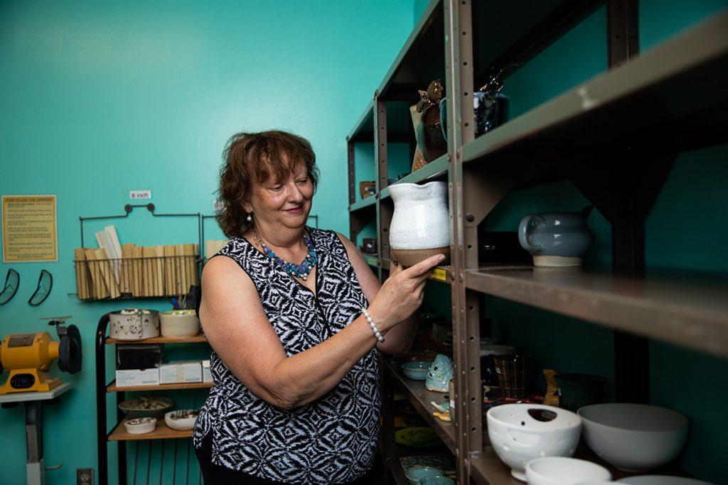 Woman holding ceramic pot